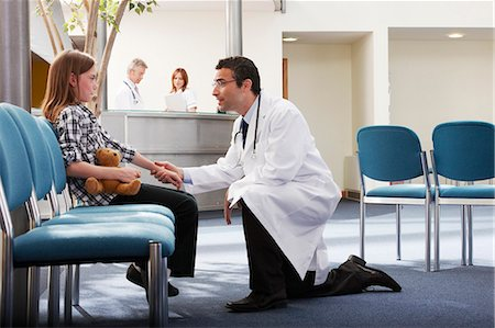 Doctor greeting young girl in surgery Stock Photo - Premium Royalty-Free, Code: 649-03621611