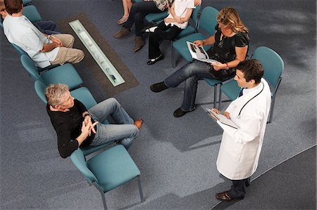 doctor in waiting room - Doctor and patients in waiting area Stock Photo - Premium Royalty-Free, Code: 649-03621621