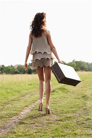 femininity - Woman with suitcase walking away Stock Photo - Premium Royalty-Free, Code: 649-03621776
