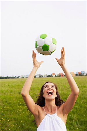 Woman catching soccer ball Stock Photo - Premium Royalty-Free, Code: 649-03621770