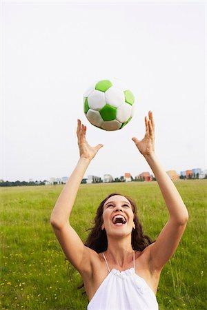 Woman catching soccer ball Stock Photo - Premium Royalty-Free, Code: 649-03621770