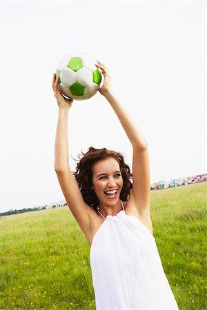 Woman holding soccer ball Stock Photo - Premium Royalty-Free, Code: 649-03621771