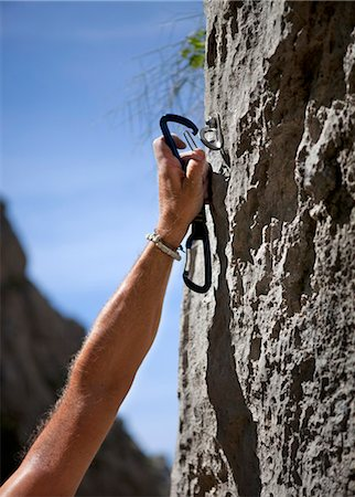Rock climber securing himself Stock Photo - Premium Royalty-Free, Code: 649-03622060