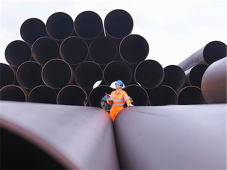 pipe (industry) - Man checking pipes Stock Photo - Premium Royalty-Free, Code: 649-03622375
