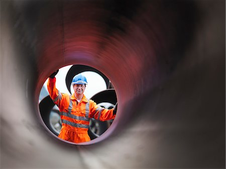 pipe (industry) - Man checking pipes Stock Photo - Premium Royalty-Free, Code: 649-03622377