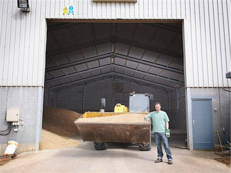Farmer in front of grain store Stock Photo - Premium Royalty-Free, Code: 649-03622453
