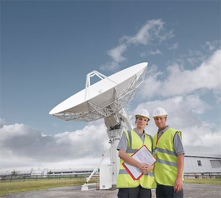 radio telescope - Workers in front of satellite dish Stock Photo - Premium Royalty-Free, Code: 649-03622492