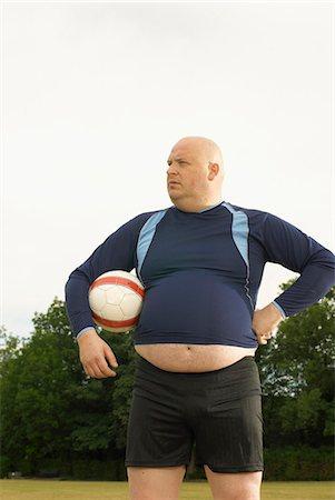 fat man balls - Large footballer Stock Photo - Premium Royalty-Free, Code: 649-03622517