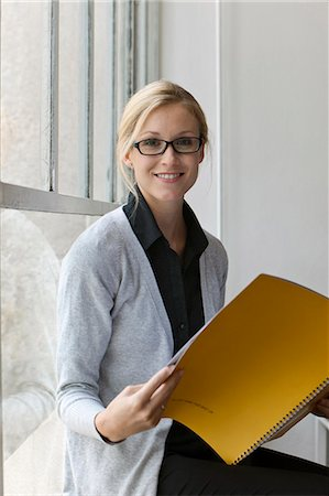 report - Woman in glasses smiling Stock Photo - Premium Royalty-Free, Code: 649-03622568