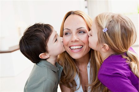 preteen kissing - brother and sister kissing her mother Stock Photo - Premium Royalty-Free, Code: 649-03666117