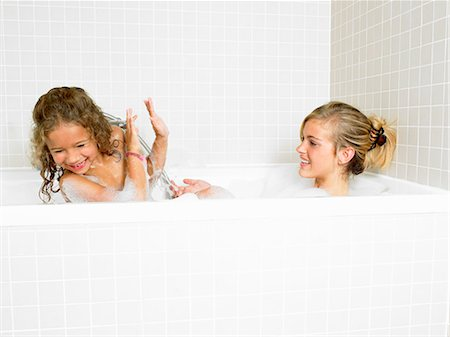 Sisters playing in a bath, foam Stock Photo - Premium Royalty-Free, Code: 649-03666426