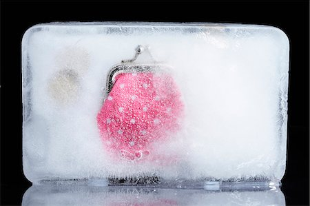 prevention - a purse frozen in ice Stock Photo - Premium Royalty-Free, Code: 649-03666755