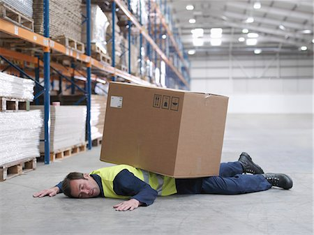 dangerous accident - Worker Flattened By Box In Warehouse Stock Photo - Premium Royalty-Free, Code: 649-03666959
