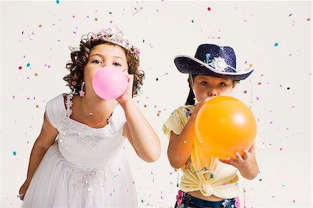 party girls blowing balloons Stock Photo - Premium Royalty-Free, Code: 649-03667235