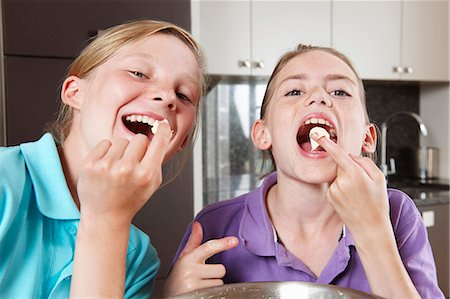 preteen girl licking - Girls cooking in the kitchen Stock Photo - Premium Royalty-Free, Code: 649-03768881