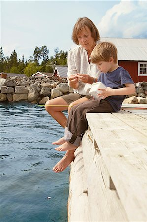 Grandmother and boy fishing from jetty Stock Photo - Premium Royalty-Free, Code: 649-03769636