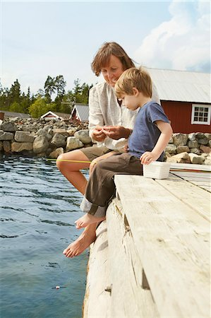 Woman with grandson fishing from jetty Stock Photo - Premium Royalty-Free, Code: 649-03769637