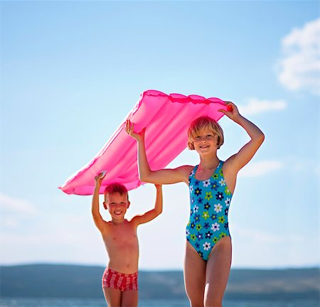 preteen girl - Children with inflatable at the beach Stock Photo - Premium Royalty-Free, Code: 649-03769746