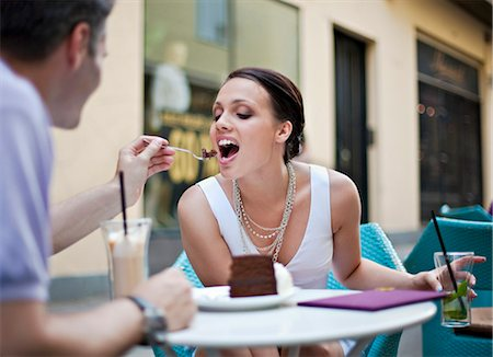 Young couple sitting in outdoor café Stock Photo - Premium Royalty-Free, Code: 649-03769826