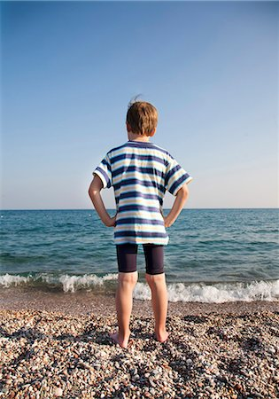 Boy (7-9) looking out to sea Stock Photo - Premium Royalty-Free, Code: 649-03774531