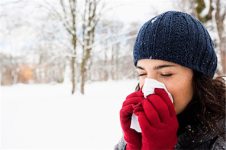people coughing or sneezing - Woman wiping her nose Stock Photo - Premium Royalty-Free, Code: 649-03774919