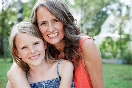 preteen long hair - Mother and daugther in garden Stock Photo - Premium Royalty-Free, Code: 649-03774974