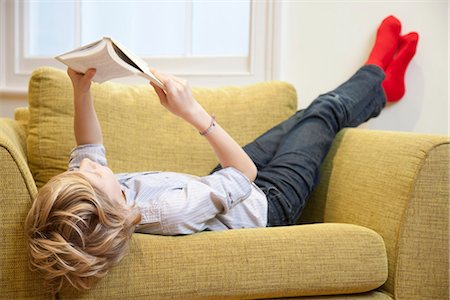 Young boy reading in an armchair Stock Photo - Premium Royalty-Free, Code: 649-03774992