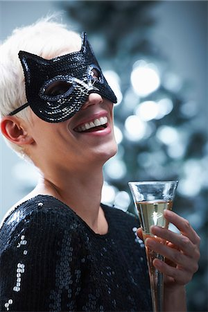 Woman wearing a cat mask Stock Photo - Premium Royalty-Free, Code: 649-03775080