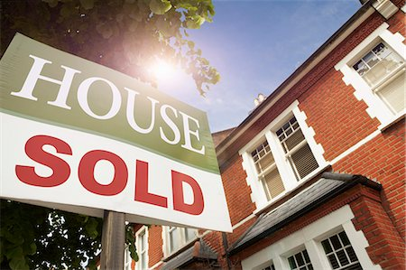 sold sign - House with SOLD notice Stock Photo - Premium Royalty-Free, Code: 649-03770416