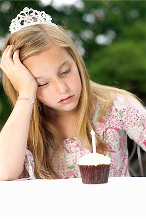 sad girls - Young girl with small cake Stock Photo - Premium Royalty-Free, Code: 649-03770438