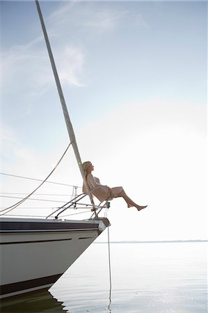 sailboat  ocean - Girls sitting on front of boat Stock Photo - Premium Royalty-Free, Code: 649-03770510