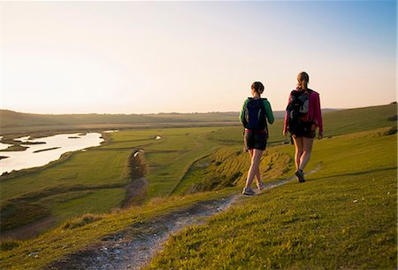 Hikers walk towards sunset Stock Photo - Premium Royalty-Free, Code: 649-03770598