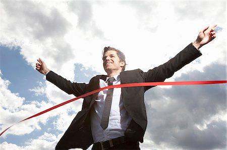 finish line - Businessman crossing finish line Stock Photo - Premium Royalty-Free, Code: 649-03770636