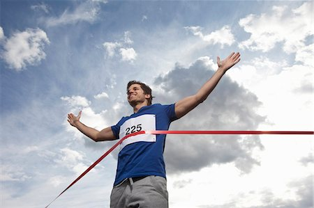 finish line - Young man crossing finish line Stock Photo - Premium Royalty-Free, Code: 649-03770638