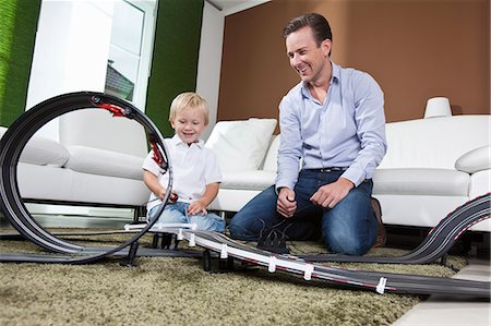 remote car - Father and son playing with race track Stock Photo - Premium Royalty-Free, Code: 649-03770647