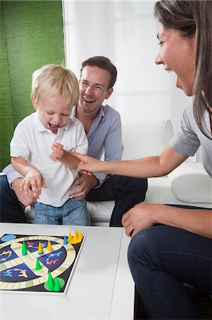 Family playing board game Stock Photo - Premium Royalty-Free, Code: 649-03770663