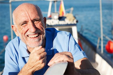 Fisherman on fishing boat Stock Photo - Premium Royalty-Free, Code: 649-03770736