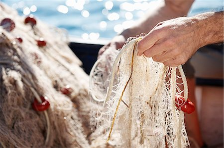 Fisherman holding nets Stock Photo - Premium Royalty-Free, Code: 649-03770742