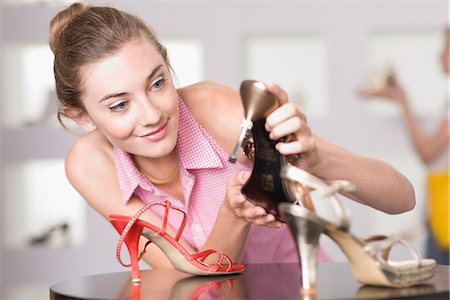 Young woman in shoe shop Stock Photo - Premium Royalty-Free, Code: 649-03771013