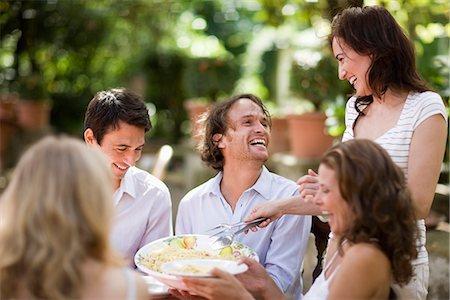Woman serving pasta Stock Photo - Premium Royalty-Free, Code: 649-03771106