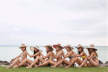 Women sitting in human chain by lake Stock Photo - Premium Royalty-Free, Code: 649-03771204