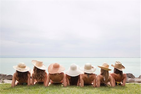 Women in straw hats recline by lake Stock Photo - Premium Royalty-Free, Code: 649-03771200