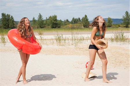 Young women laughing on the beach Stock Photo - Premium Royalty-Free, Code: 649-03771214
