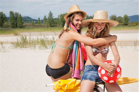 Smiling women together on the beach Stock Photo - Premium Royalty-Free, Code: 649-03771216
