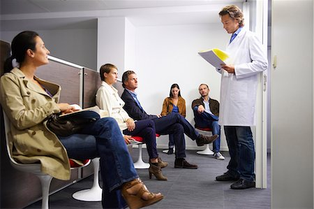 doctor in waiting room - Doctor calling a patient in waiting room Stock Photo - Premium Royalty-Free, Code: 649-03771564