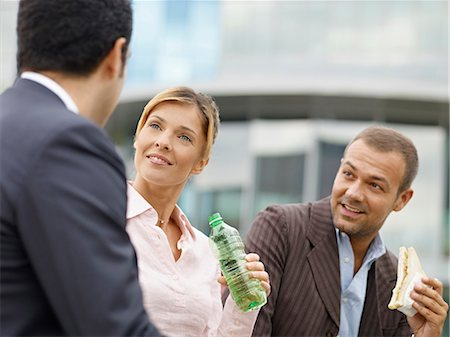 Businesspeople eating outdoors Stock Photo - Premium Royalty-Free, Code: 649-03771585