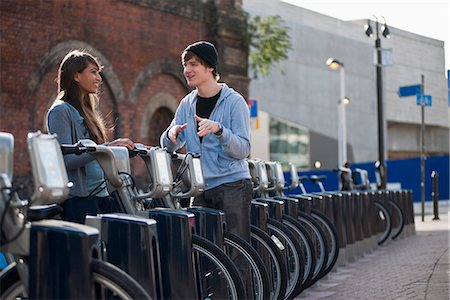 renting - Young couple talking with rented bicycle Stock Photo - Premium Royalty-Free, Code: 649-03771714