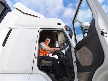 side view tractor trailer truck - Truck driver looks down from truck Stock Photo - Premium Royalty-Free, Code: 649-03773426