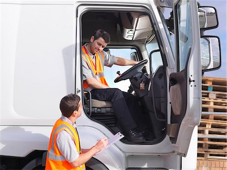 side view tractor trailer truck - Truck driver and dispatch worker talk Stock Photo - Premium Royalty-Free, Code: 649-03773428