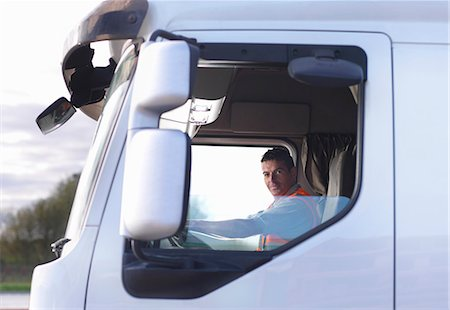 side view tractor trailer truck - Truck driver in cab Stock Photo - Premium Royalty-Free, Code: 649-03773434